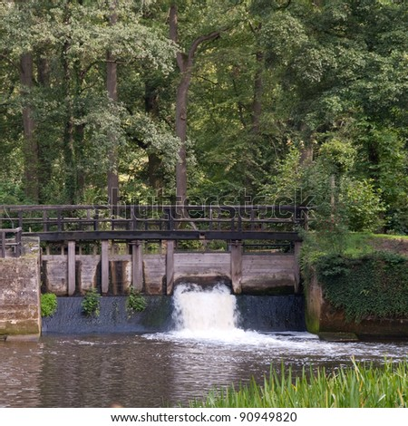 Weir on a country estate in the Netherlands - stock photo