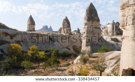 Weird and unique landscape in Cappadocia in Turkey. You will never find something similar in this world! This area is a popular tourist destination. - stock photo
