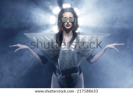 Weird dressed girl in glasses - stock photo