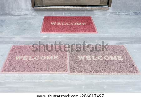 welcome doormat on the stair of guesthouse. - stock photo