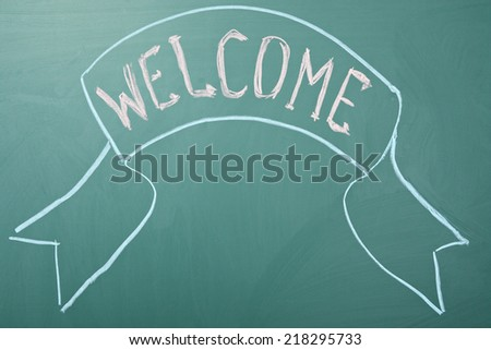 Welcome. Greeting on a blackboard - stock photo