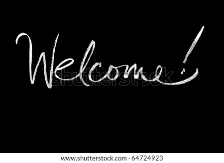 welcome handwritten in script in chalk on a blackboard - stock photo