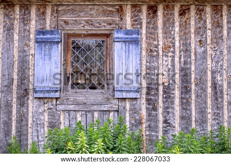 Welcome Home. Historical country cottage with pane glass window and blue shutters.  - stock photo