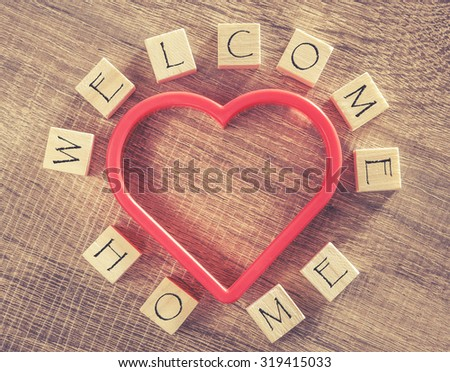 Welcome Home message. Cross processed image for vintage look - stock photo