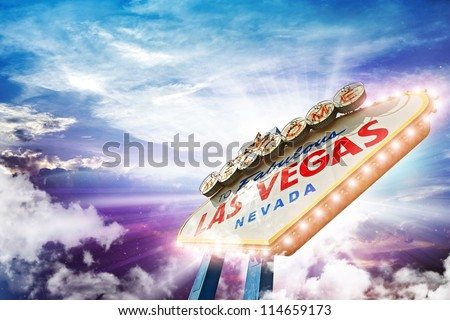 Welcome in Las Vegas - Illuminated Vegas Sign on Colorful Cloudy Sky. - stock photo