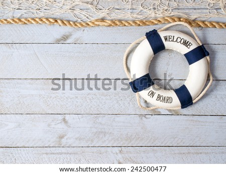 Welcome on Board - lifebuoy on wooden background and copy space for individual text - stock photo