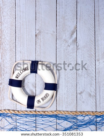 Welcome on Board - lifebuoy on wooden background, copyspace for individual text - stock photo