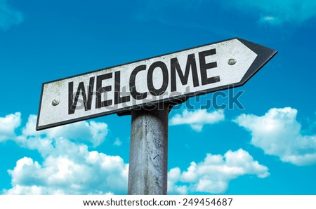 Welcome sign with sky background - stock photo