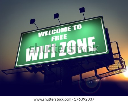 Welcome to Free WiFi  Zone - Green Billboard on the Rising Sun Background. - stock photo