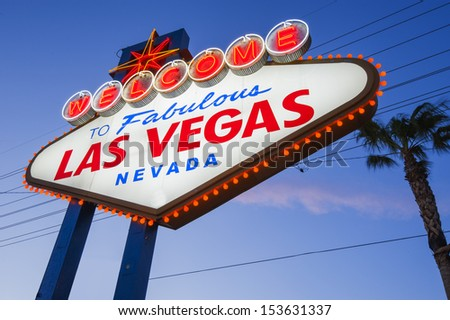 Welcome To Las Vegas neon sign on sunset sky - stock photo