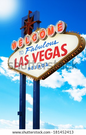 Welcome to Las Vegas neon sign with cloudy blue sky - stock photo