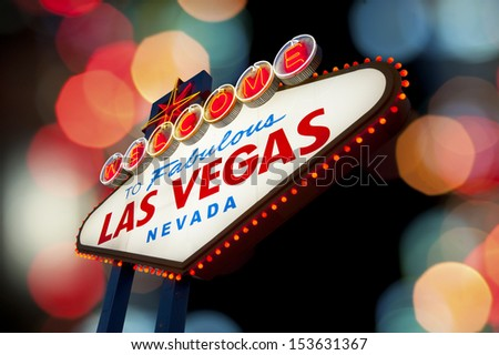 Welcome To Las Vegas neon sign with light bokeh background - stock photo