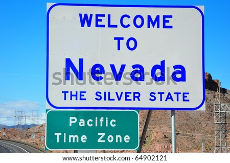 Welcome to Nevada and pacific time zone road signs - stock photo