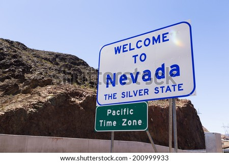 Welcome to Nevada sign along the highway - stock photo