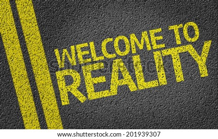 Welcome to Reality written on the road - stock photo