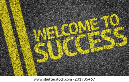 Welcome to Success written on the road - stock photo