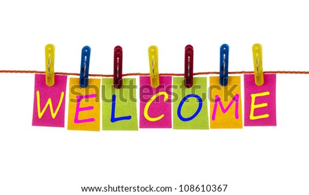 Welcome word on laundry hook on white - stock photo