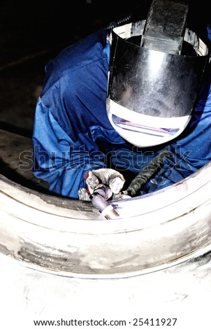 Welder at work. - stock photo