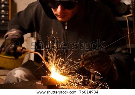 welder at work doing his job - stock photo
