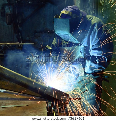 Welder in a factory - stock photo