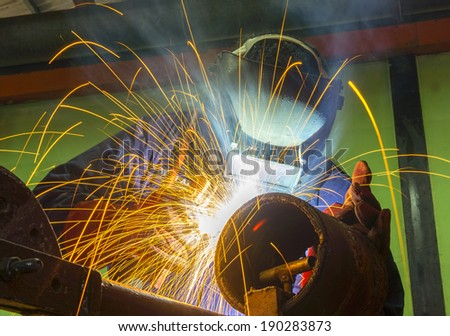 welder in action at workshop - stock photo