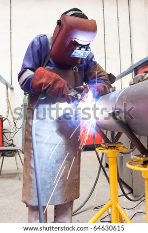 welder in factory - stock photo