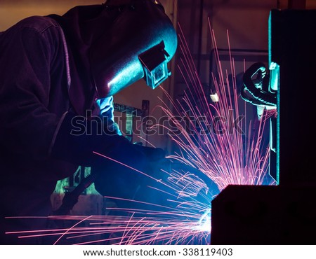 Welder movement Industrial automotive part in factory - stock photo