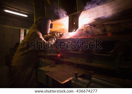 Welder repairing machinery at the plant of a Copper Mine in Chile - stock photo