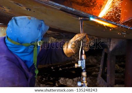 Welder weld metal in shipbuilding, Welder, photography - stock photo