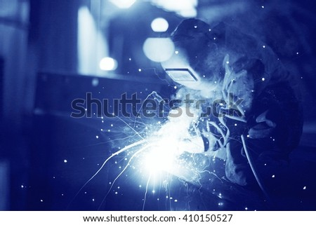 welder working at the factory - stock photo