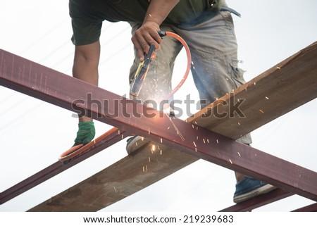 Welders welding metal, Welding work. - stock photo