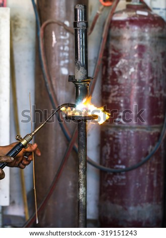 Welders were repairing cutting Shock absorbers of a car - stock photo