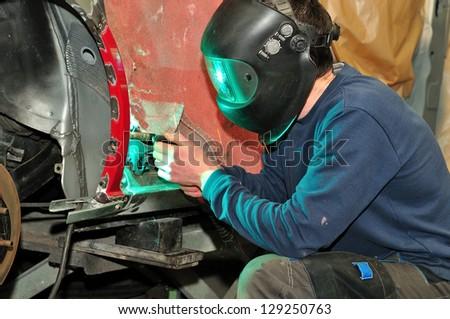 Welding car body. - stock photo