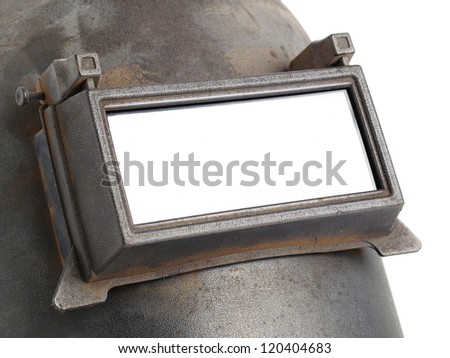 Welding mask detail on white background. The visor is closed and you see the impact of weld slag. - stock photo