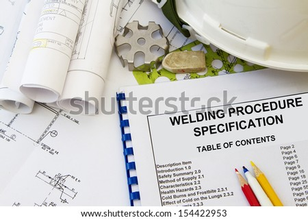 Welding procedure specification and engineering tools with hard hat. - stock photo