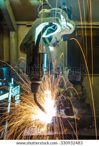 welding Robot movement Industrial automotive part in factory - stock photo
