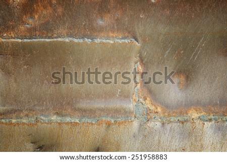 welding seam old iron background - stock photo