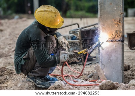 Welding work for concrete pile of building - stock photo