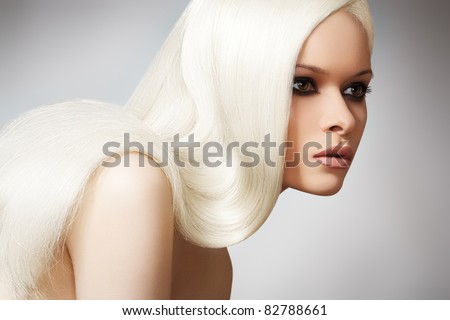 Well-being & spa. Sensual woman model with shiny straight long blond hair and chic evening make-up. Health, beauty, wellness, haircare, cosmetics and make-up. Beautiful fashion platinum hairstyle - stock photo
