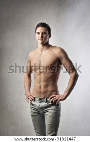 Well-built young man - stock photo