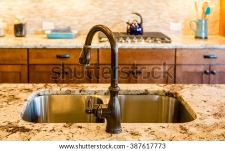 Well decorated and modern kitchen with granite countertops - stock photo
