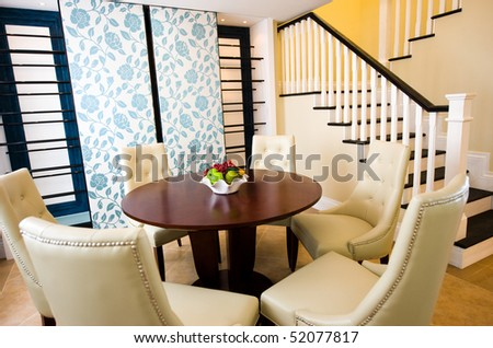 Well decorated formal dining room in a luxury home. - stock photo