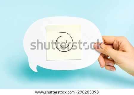 Well done, card feedback, employee recognition concept. Happy emoticon on speech bubble on blue background. Chatbot. - stock photo