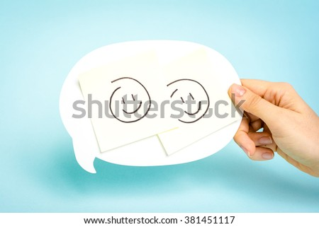 Well done. Employee award concept. Two happy emoticons on speech bubble on blue background. - stock photo