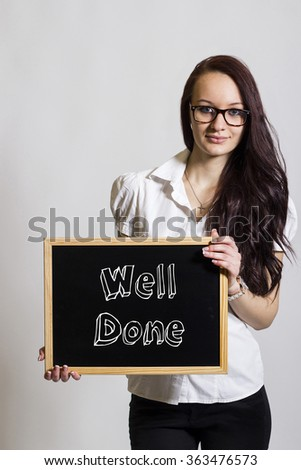 Well Done - Young businesswoman holding chalkboard - vertical image - stock photo