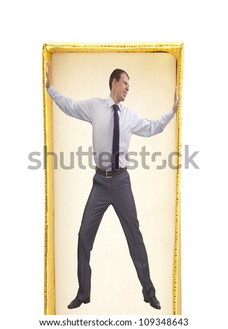 Well dressed businessman in a tight cardboard box isolated on white background - The symbol suffering distress bondage slavery limited - stock photo