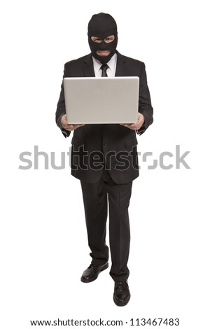 Well dressed criminal holds a laptop computer - stock photo
