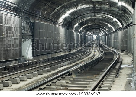 Well Illuminated Empty Subway Tunnel, Two Railroads - stock photo