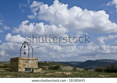 well in tuscany - stock photo
