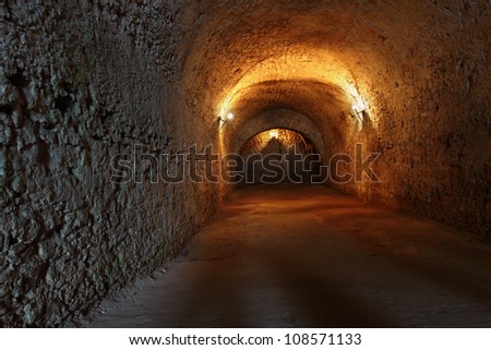 Well lit catacombs of the castle in Dubno, Ukraine - stock photo